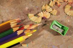 Coloured Pencils, Pencil Sharpener And Pencil Shavings Stock Image