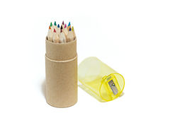 Coloured pencils in a round box. Several coloured pencils in a round cardboard box, isolated on white background stock photography