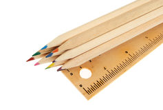 Coloured pencils and rule Royalty Free Stock Images