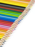 Coloured pencils on white background Royalty Free Stock Photos