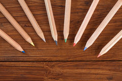 Coloured pencils on wood Royalty Free Stock Images