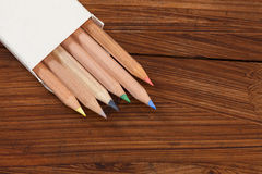 Coloured pencils on wood Royalty Free Stock Image