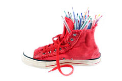 Coloured pens in sneakers Royalty Free Stock Photo
