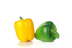Coloured pepper. Yellow and green pepper on a white background Stock Photo