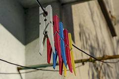 Coloured plastic clothes pins or peg on rope, Sofia. Bulgaria stock photography
