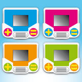 Coloured portable video games Stock Photo