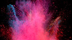 Coloured powder explosion. Super slow motion of coloured powder explosion isolated on black background. Filmed on high speed cinema camera, 1000fps stock footage