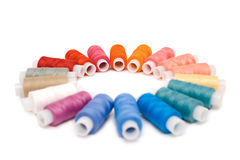 Coloured reels of thread Stock Images