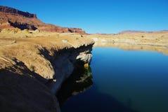 Coloured rocky shore of Colorado river near Hite, Utah Royalty Free Stock Photos