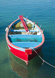 Coloured rowboat in clear sea. Stock Photography