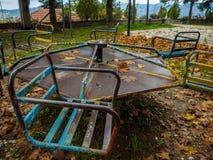 Coloured rusty playground in autumn stock photos