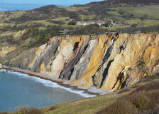 Coloured sand. Landscape picture of different coloured sand on cliff over the sea Royalty Free Stock Photography