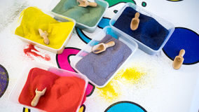 Coloured sands. Several coloured sands in plastic containers in a sand art activity. Photo taken on March 2nd, 2015 Royalty Free Stock Images
