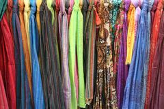 Coloured scarves. Hang around beside each other royalty free stock photos