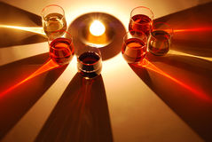 Coloured shadows of wine glass illuminated by a candle Stock Photos