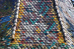 Church roof covered with typical tiles in Sighisoara, Romania Stock Image