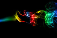 Coloured smoke. With a silk touch on black background royalty free stock photography