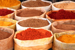 Coloured spices. Bags in a market in morocco, africa Royalty Free Stock Images