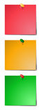 3 Coloured Sticky Notes. Red, orange and green sticky notes with pins isolated on awhite background Stock Images