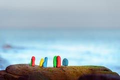 Coloured stones at coast Stock Photos