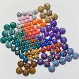 Coloured stones. Shot of semi-precious stone cabochons stock photos