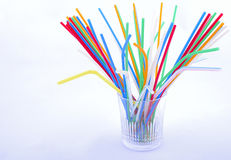 Coloured straw at glass. Different coloured straw at glass royalty free stock photos