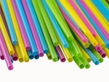 0641 Coloured straws, bundles on a white background royalty free stock image