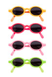 Coloured Sunglasses. Coloured pairs of sunglasses isolated on white stock photo
