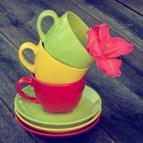 Coloured teacups  on a table Stock Photo