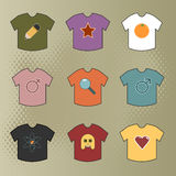 Coloured tees with motifs Royalty Free Stock Photos