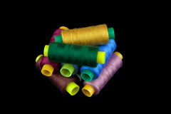 Coloured thread isolated on black background Stock Photo