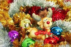 Coloured tinsel and Christmas-tree decorations Royalty Free Stock Photo