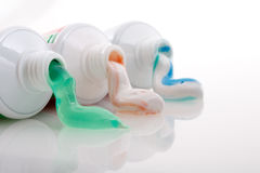 Coloured toothpaste. Coming out of a tube Royalty Free Stock Photography
