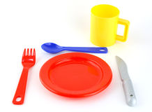 Coloured toy set of cutlery. A colored set of cutlery with spoon, fork, knife, glass Stock Image