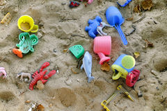 Coloured toys in a sandbox Royalty Free Stock Photos
