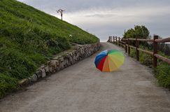 Coloured umbrella. Capture of a rainbow umbrella in the way Royalty Free Stock Photos