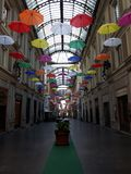 coloured umbrellas over the city of Genova for the pride month stock images