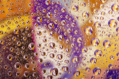 Coloured water drops Stock Image