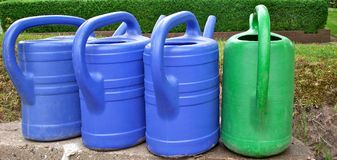 Coloured watering cans Royalty Free Stock Photos