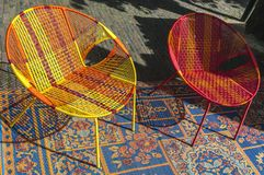 Coloured wicker chair on a blanket stock photography
