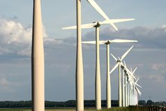 Coloured wind turbines in a row Royalty Free Stock Photography