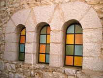 Coloured windows. Three ancient windows with coloured glasses royalty free stock image