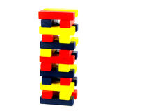 Coloured Wooden Blocks Stacked Against a White Background Royalty Free Stock Image