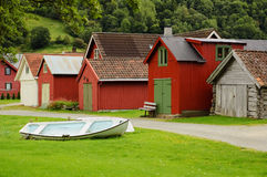 Coloured wooden buildings and the boat Royalty Free Stock Photography