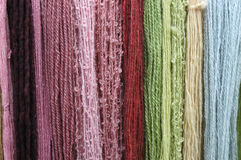 Coloured Wool. Strands of different types and colours of wool royalty free stock images