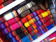 Coloured woollen textiles for sale in shop. Folded woollen textiles on display and for sale in a shop in Peru Royalty Free Stock Photography