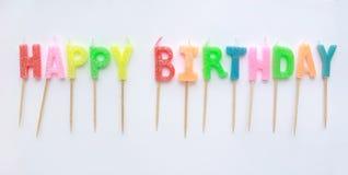 Coloured wszystkiego najlepszego z okazji urodzin świeczki na białym tle obraz royalty free