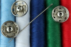 Coloured yarn with buttons. Detailed image of colored yarn, needles and buttons stock photography