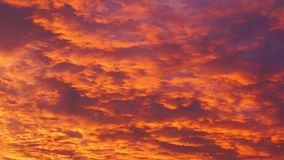 Colourful afterglow cloudy sky pan stock footage