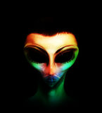 Colourful Alien Hybrid. Alien human hybrid that is a staring in a sinister way Stock Photos